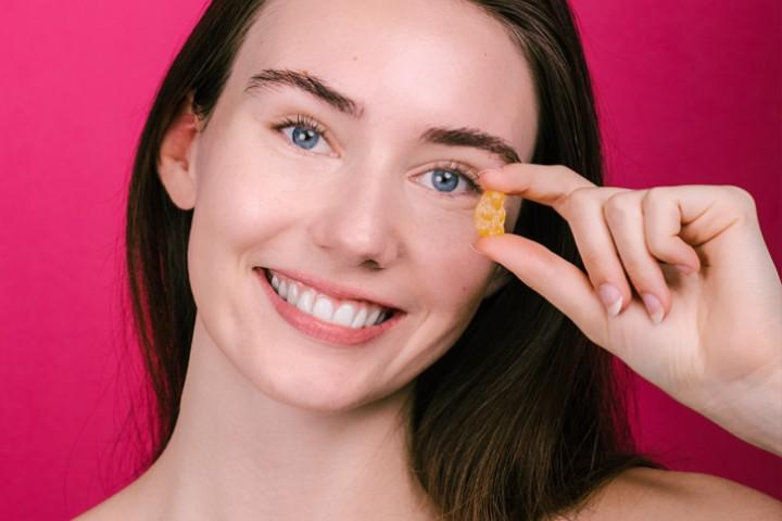 Girl using cbd gummies
